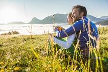 Couple Sitting On A Meadow In ...
