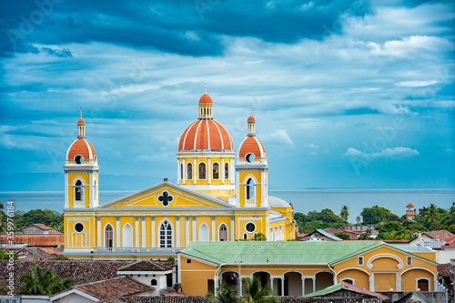 Photo Cathedral of Granada from rooftop, with Lake Nicaragua in the background