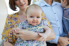 Close Up Of Baby With Family I...
