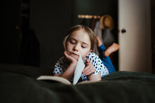 Young Girl Reading A Book At H...