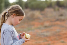 Little Girl With Apple Outside...