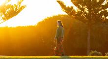 Teenager Back-lit Walking Past...
