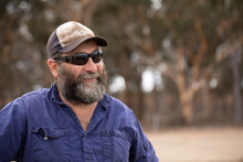 Head And Shoulders Of Bearded Man Wearing Sunglasses And Cap