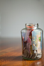 Australian Money Notes And Coins In Jar On Wood With White Copy Space