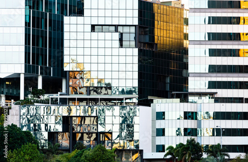 Reflections and geometric patterns in city buildings creating abstract effect - 359995123