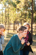 Mum And Daughters Laughing Tog...