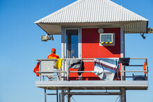 A Surf Lifeguard Sitting In A ...