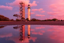 A Lighthouse And Its Reflectio...