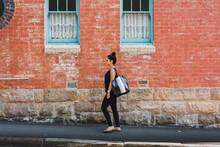 Woman Walking In Urban Area