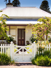 Country Cottage With Inviting Entrance Through The Gate