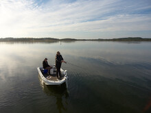 Casting A Lure From A Boat While Fishing