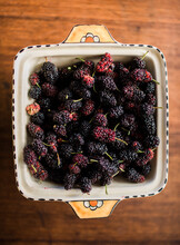 Mulberries In A Dish On Wooden Bench