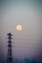 Big Moon And A City Sky With P...