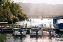 Boats Docked At A Jetty