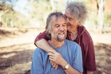 Happy Elderly Couple Hug In Th...
