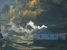 Farm House With Smoke Coming F...