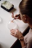 Skilled woman creating handmade Christmas ornament