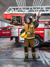 Professional Fireman Climber Standing Near Fire Truck