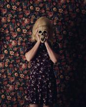 Girl Holding Scary Skeleton On...