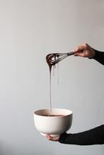 Crop Hands Draining Chocolate ...