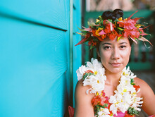 Tahitian Woman At Turquoise Plantation House In Hawaii With Surfboard And Shower And Floral Crown