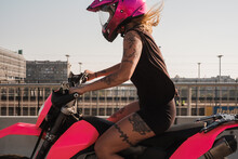 Woman With Pink Helmet Riding ...
