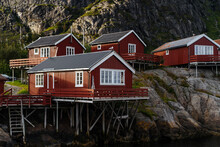 Red Cabins On Mountain Slope