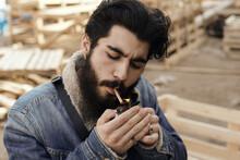 Stylish Man Lighting Up Cigare...