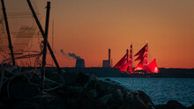 A Ship With Red Sails At Sunse...