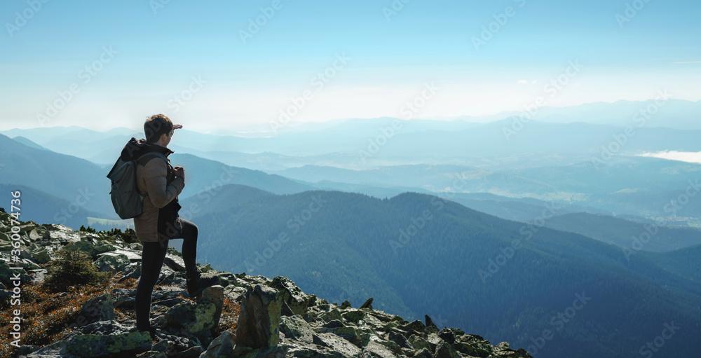 Fototapeta Happy hiker winning reaching life goal, success, freedom and happiness, achievement in mountains. Lifestyle wanderlust adventure. Carpathian mountains, Ukraine, Europe