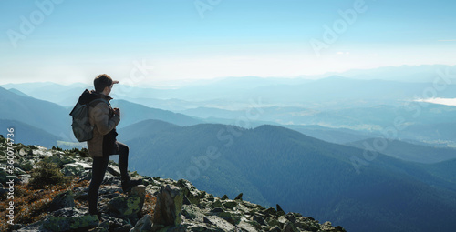 Happy hiker winning reaching life goal, success, freedom and happiness, achievement in mountains Canvas Print