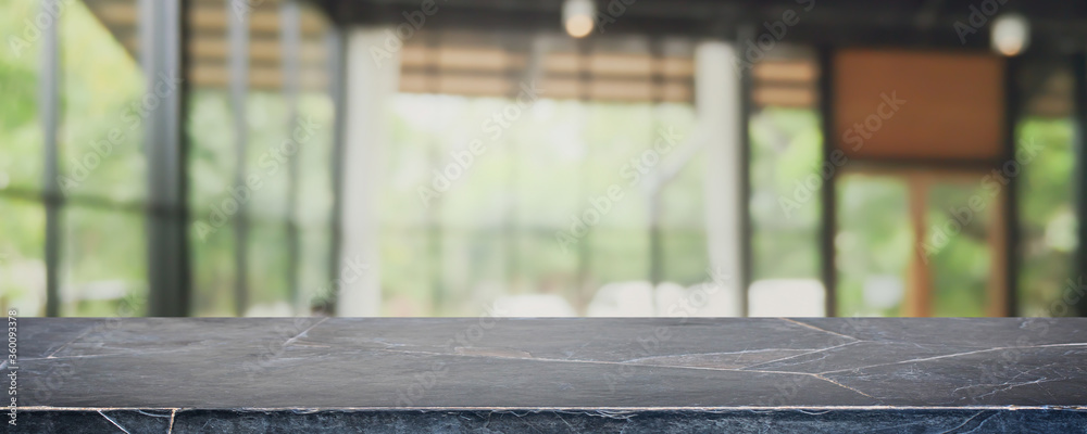 Fototapeta Empty black marble stone table top and blurred coffee shop, cafe and restaurant interior background - can used for display or montage your products.