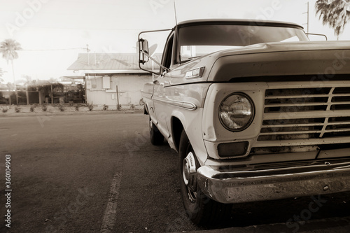 Classic vintage American truck parked in a suburban parking lot. #360104908
