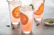 Leinwandbild Motiv Grapefruit cocktail with rosemary, refreshing cold drink
