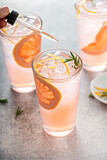 Grapefruit cocktail with rosemary with bitters in a drop