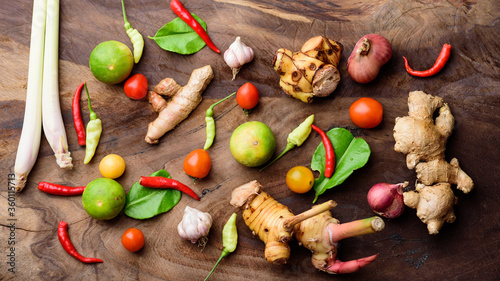 Fototapeta Thai food ingredients, spices and herbs for cooking on wooden background, organic vegetables obraz na płótnie