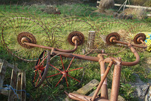 An Old Rusty Wheel Hay Rake In...