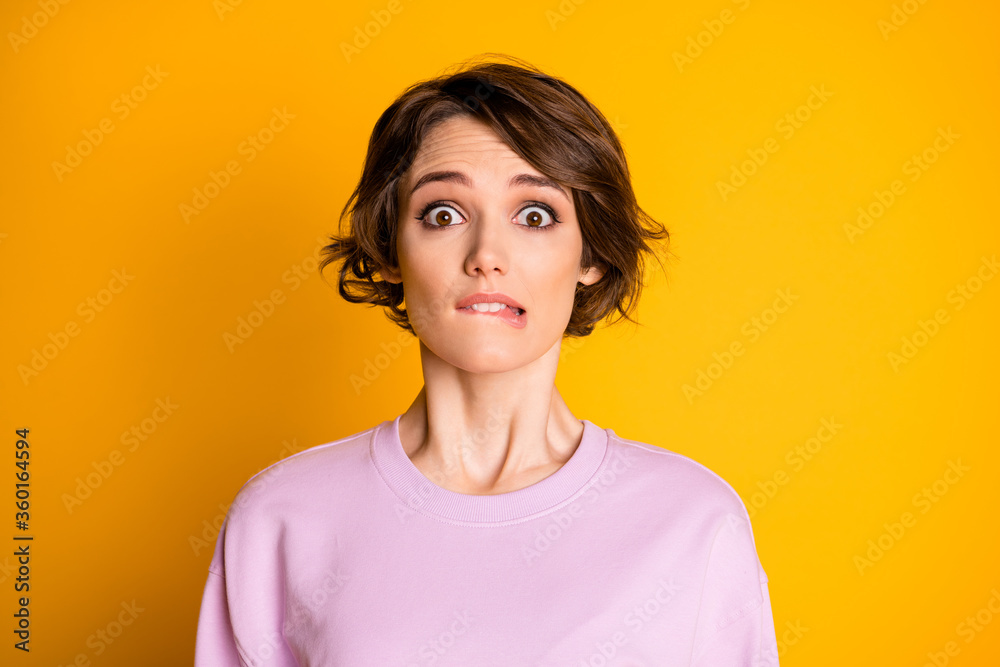 Fototapeta Close-up portrait of her she nice attractive lovely cute worried scared depressed girl biting lip waiting bad news isolated on bright vivid shine vibrant yellow color background