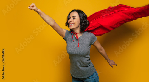 I am coming to you! A half-length photo of a young, beautiful girl, pretending she is a superwoman, and flying in a classic superman pose, because she is flying to help someone Canvas-taulu
