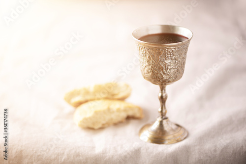 Canvastavla Unleavened bread, chalice of wine, silver kiddush wine cup on canva background