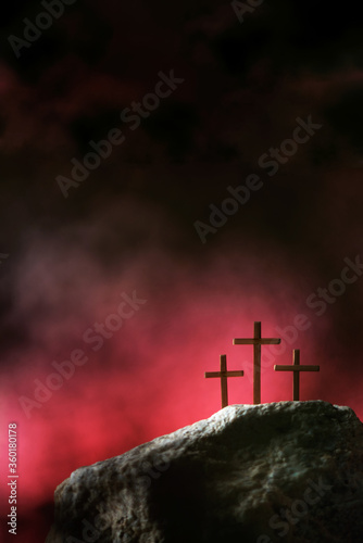 Tableau sur Toile Three crosses against red sky on Calvary hill background