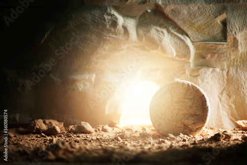 """Empty tomb of Jesus Christ with light. Born to Die, Born to Rise. """"He is not here he is risen"""". Savior, Messiah, Redeemer, Gospel. Alive. Christian Easter concept. Jesus Christ resurrection. Miracle"""