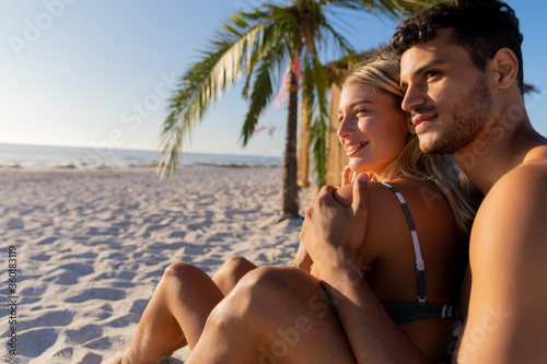 Caucasian couple enjoying time at the beach
