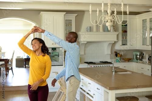 Fotografija Happy couple dancing in their kitchen