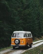 Vintage Volkswagen Camper Van On Forest Road. Transportation Travel.