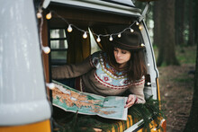 Traveler Girl Sitting In The Retro Car Looking Map.