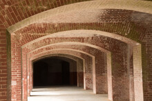 Infinity View Of Curved, Blonde And Red Brick Tunnel With Rectangular And Horizontal Patterns Under Golden Gate Bridge In San Francisco, California