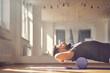 Leinwandbild Motiv Bearded man lying on foam roller during training in studio