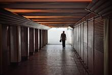 A Man Goes Through An Underpass.