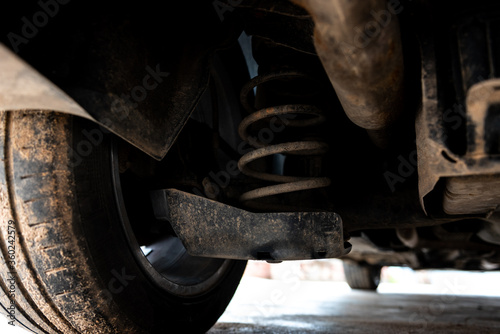 Photo Close up of shock absorber under car.